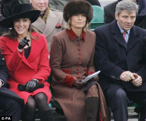 Kate with her parents Carole and Michael at Sandhurst in 2006