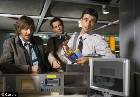 Businessmen at airport check-in