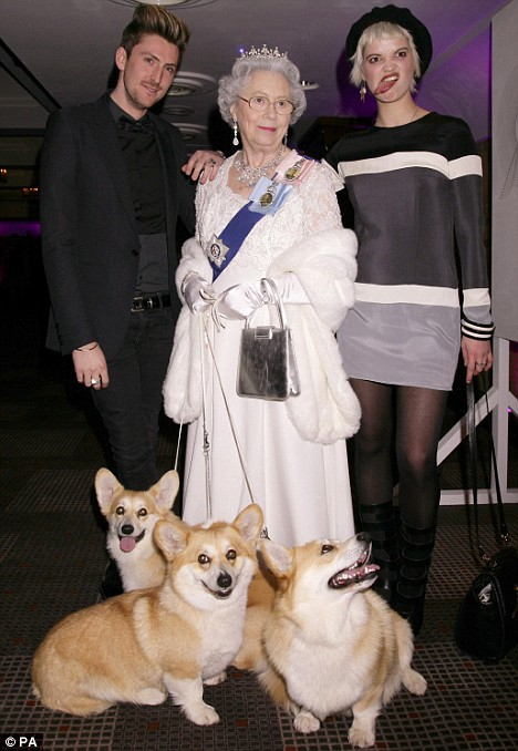 Henry Holland and Pixie Geldof pose with Queen Elizabeth II impersonator, Mary Reynolds