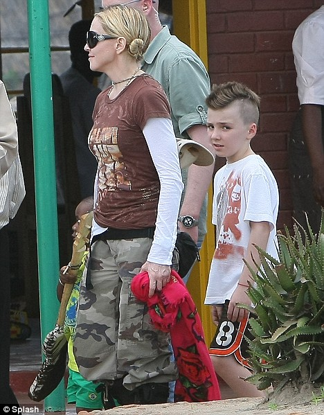 Madonna visits with her family, Lourdes, Rocco, David Benda the Mphandula Child Care Center