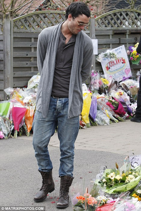 Jack Tweed and his closest friends are pictured reading tributes outside Jade Goody's Essex home
