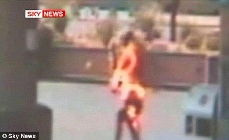 The victim flails about in flames until a quick-thinking employee turned a water hose on him