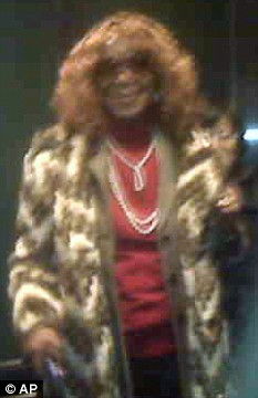 In this cell phone photo provided by TheBostonChannel.com, President Barack Obama's aunt Zeituni Onyango, wearing a curly wig, leaves the immigration hearing in Boston yesterday