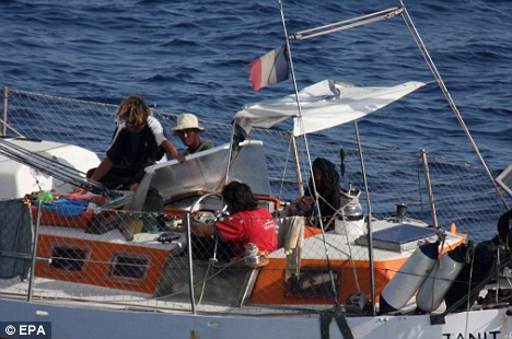 Skipper Florent Lemacon can be seen being threatened by the armed pirates that seized his boat Tanit on April 4