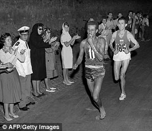 Ethiopian Abebe Bikila on his way to gold in the 1960 Olympic marathon - running barefoot