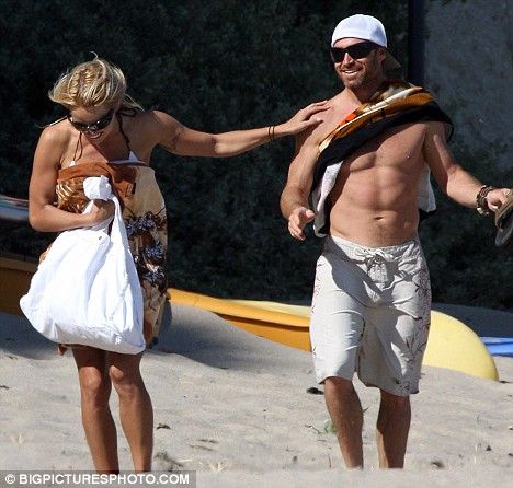 Beach babes: The two have been dating for four months