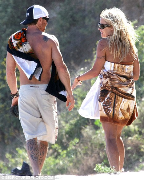 Soul mates? Pamela and her man chatted away as they spent the day together