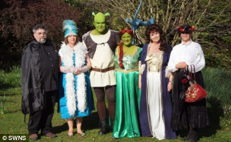Fairytale line-up: Fancy dress guests pose at the wedding today