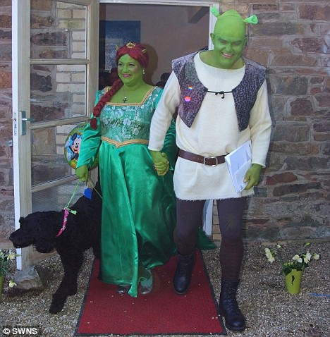 The (bright) Green couple stoll out after the service, along with their pet dog, perhaps taking on the role of Donkey