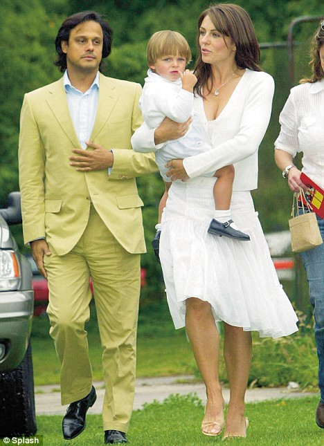 Country life: Liz, husband Arun Nayer and her son Damian attend the Ampney Crucis village fete in 2004