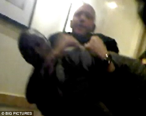 Ledley King being restrained outside Punk nightclub