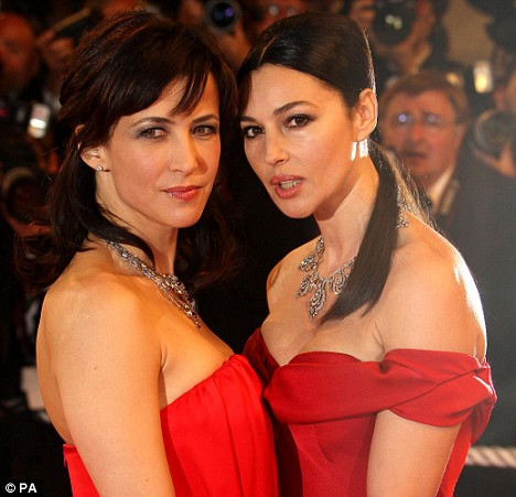 Sophie Marceau (left) and Monica Bellucci arrive at the premiere of  'Don't Look Back'