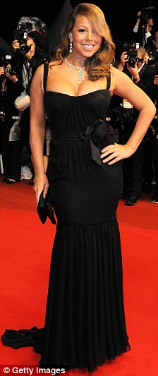 Mariah Carey attends the Precious Red Carpet held at the Palais des Festivals