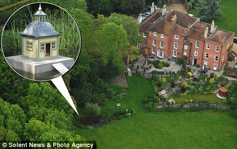 The duck house that ruffled feathers: The pond in the grounds of Sir Peter's Hampshire home