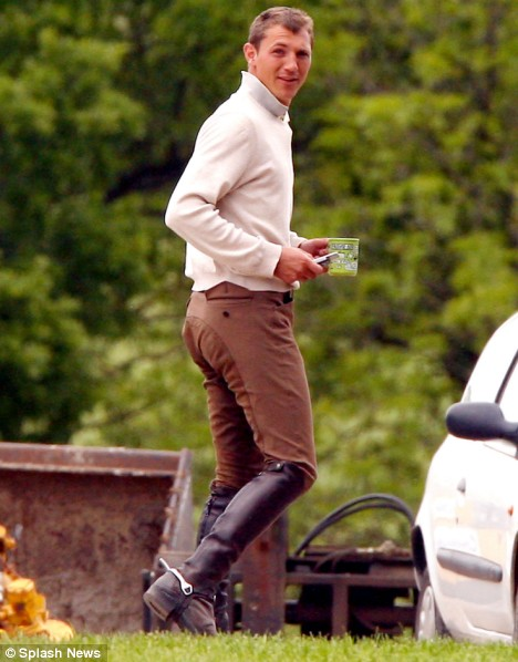 Andrew Gould walks across his Sussex stables