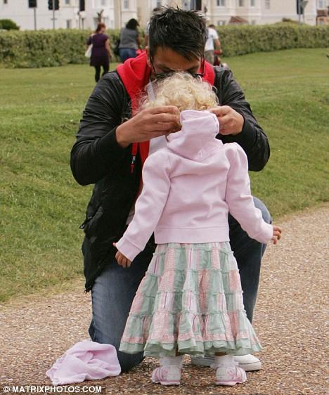 Keeping warm: Peter pulls princess' jacket on