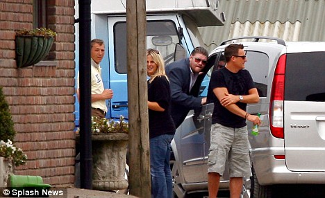 Reunion: Andrew Gould, left, greets Katie as her van arrives at a Sussex stables