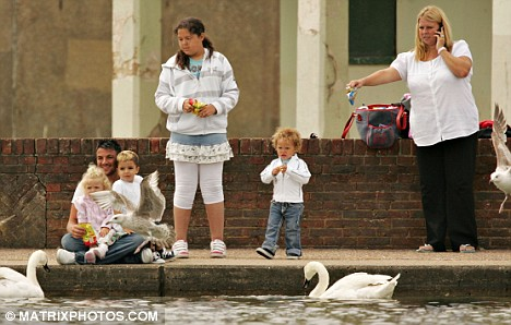 Feeding the birds: Peter and his children are seen with his agent Claire Powell, who no longer represents Katie Price