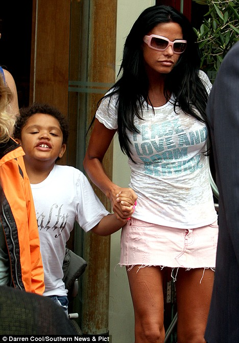 Home at last: Katie is reunited with her son Harvey and took the youngster to Donatello's restaurant in Brighton, yesterday