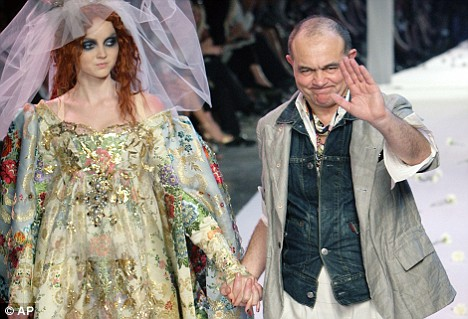 Recession hit: Mr Lacroix on the catwalk with Lily Cole who models one of his designs