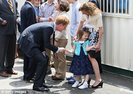 Charming: the Prince gets a shy giggle from Madisen Iken. Her mother Monica lost her husband during the terrorist attack