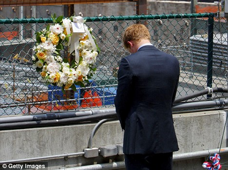 Prince Harry pauses after placing a wreath at the World Trade Center site in lower Manhattan this afternoon