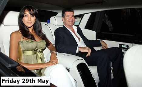 St Claire accompanied Cowell as he left the studio after the semi-finals last night too