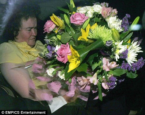 Exit the Teary Angel with a bouquet of broken dreams: Susan Boyle returns to her hotel after losing to Diversity in the Britain's Got Talent final