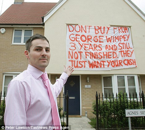 Banner protest: Homeowner Paul Willey complains of faults in his home