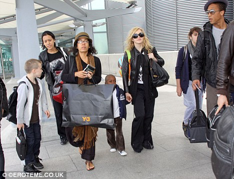 Off to see Mercy? Madonna was accompanied by a group of assistants, as well as her children