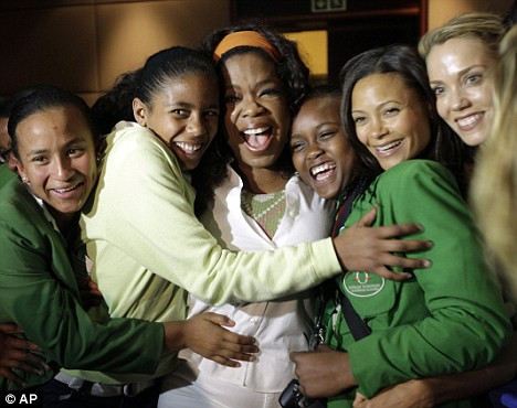 Celebration: Oprah (C) and British actress Thandie Newton, (2nd R), pose for pictures with pupils