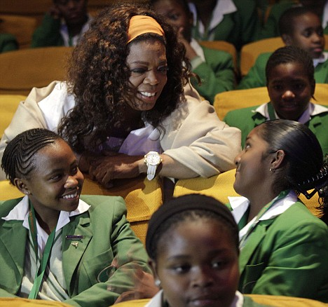 Generous: Oprah Winfrey speaks with students at the Oprah Winfrey Leadership Academy for Girls in South Africa on Friday
