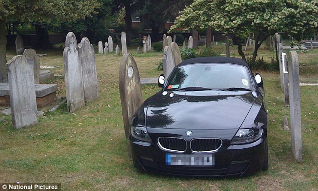 A tennis fan wanting to park as close as possible to Wimbledon has paid St Mary's Church £20 for the day to park their BMW between to grave stones