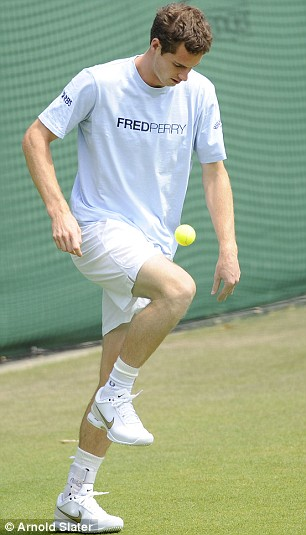Andy Murray plays football during practice today