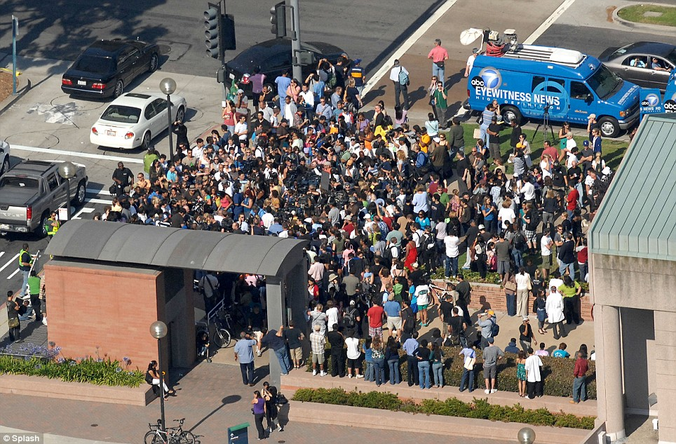 Pictured are the hundreds of people gathered at 'UCLA Medical Plaza' in Westwood, Los Angeles