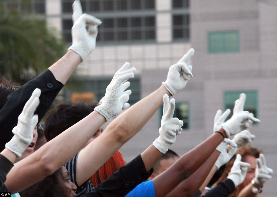 Fans hold up a sea of single gloved hands in an impromptu celebration of the life of Michael Jackson