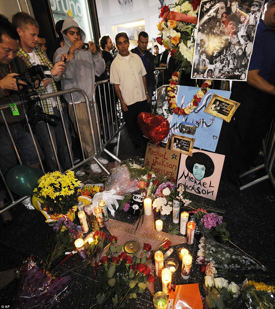 Michael Jackson fans gather around Jackson's star on the Hollywood Walk of Fame