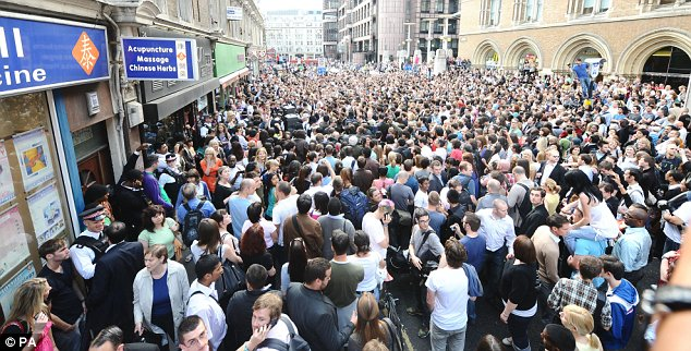 Crowds gathered for a flash mob tribute to Michael Jackson outside Liverpool Street station in London yesterday