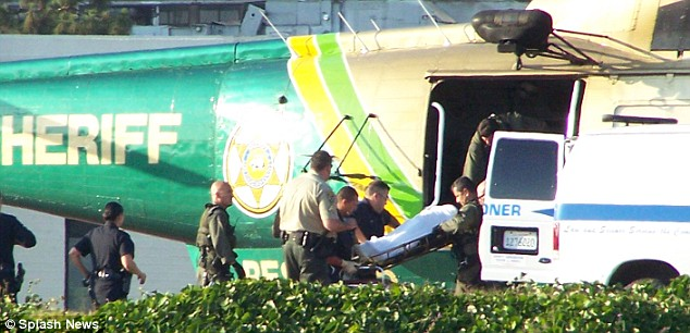 Sad journey: The body of Michael Jackson is lifted from a helicopter and into a waiting coroner's van