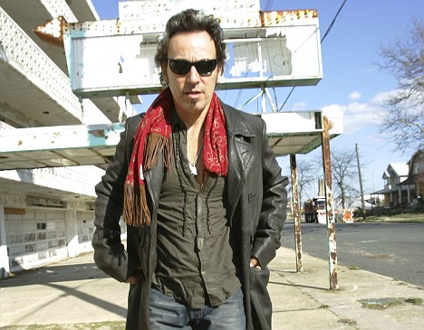 Springsteen walks past a decaying hotel in Asbury Park