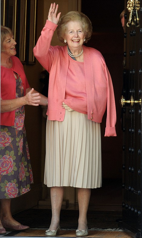 In good spirits: Baroness Thatcher waves to well-wishers as she returns to her London home after two weeks in hospital