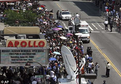 Fans line up outside the Apollo Theatre to pay their respects