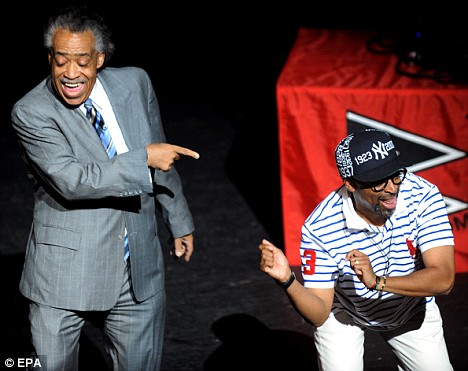 Despite the sombre feelings of the week, Reverend Al Sharpton (left) and filmmaker Spike Lee dance and laugh during a memorial to Jackson's life in Harlem