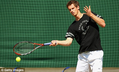 Andy Murray hits a forehand during a practise session at Wimbledon today