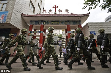 Chinese soldiers patrol the streets of Urumqi