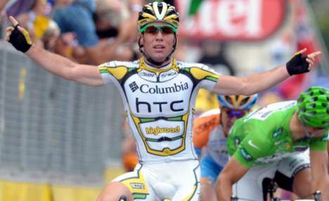 Columbia team rider Mark Cavendish of Britain celebrates winning stage 10 at Issoudun
