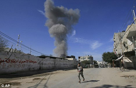 A Palestinian runs away from an explosion