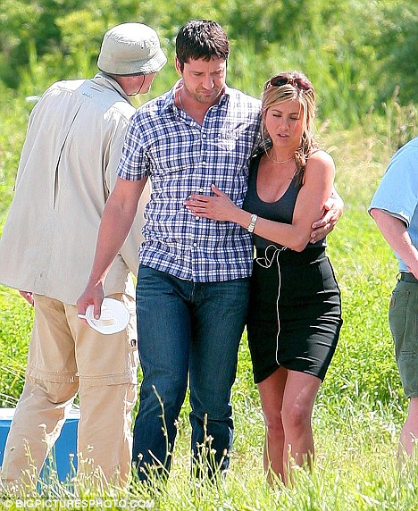 Still looking for love: Jennifer Aniston and Gerard Butler relax in a quiet moment on the set of their film The Bounty
