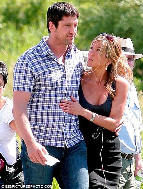 The look of love? Jennifer gazes into Gerard's eyes