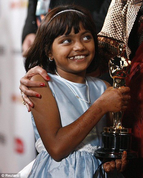 """Rubina Ali, Cast member from the movie """"Slumdog Millionaire"""" holds the Oscar belonging to director Danny Boyle at the official Oscar after party"""